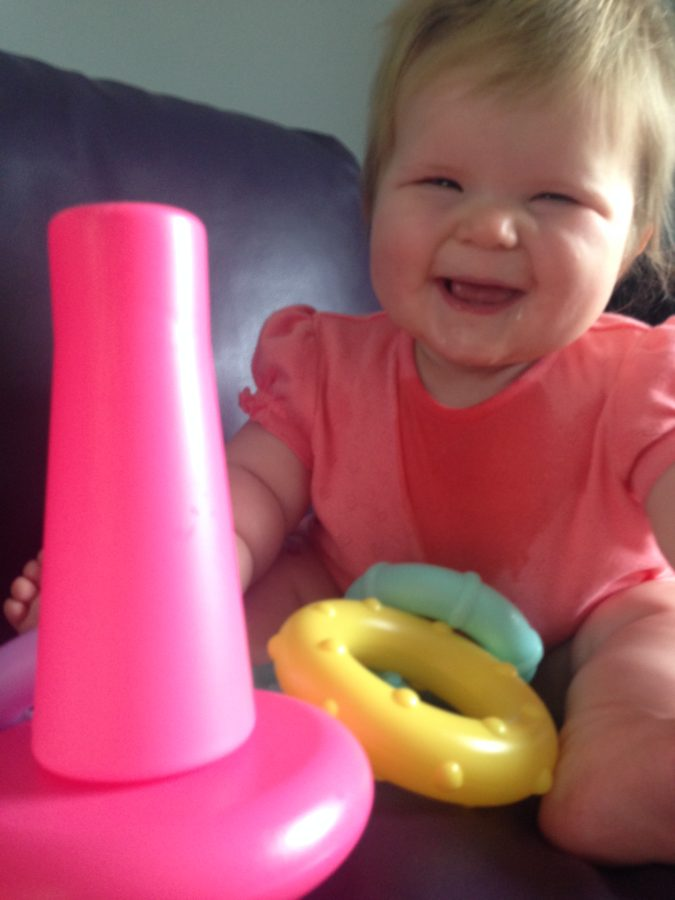 Baby with stacking toy