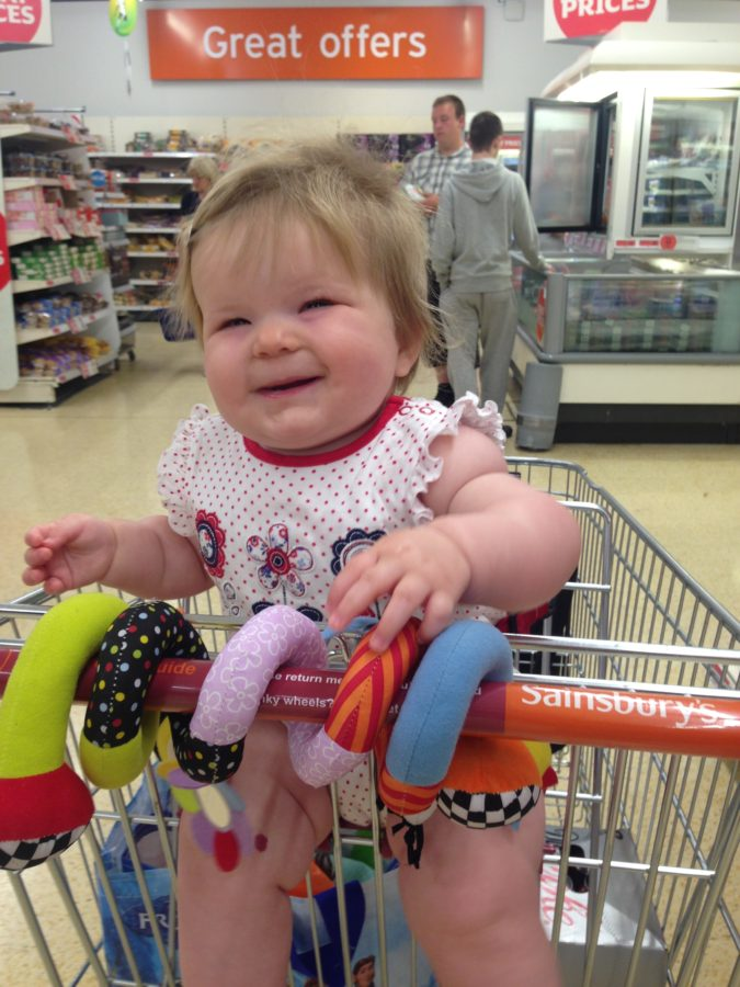 Baby in shopping trolley