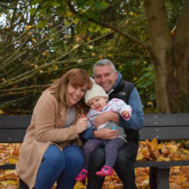 Family of three on bench