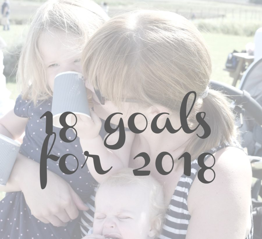 faded photo of mother cuddling two daughters with 18 goals for 2018 written over it